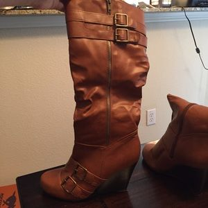 3 1/2 inch heeled, calf height boots.