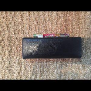 Cleo & Patek leather clutch