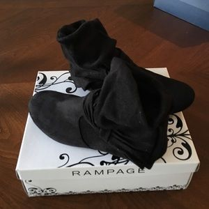 Like new black boots with bow on side