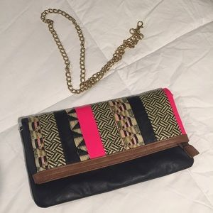 ALDO pink and black tribal clutch