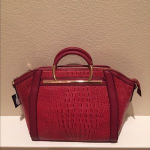 Red tote with faux croc design.