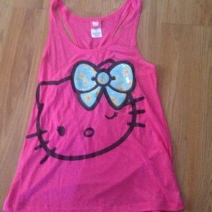 Pink and black tank top . Can also fit a large