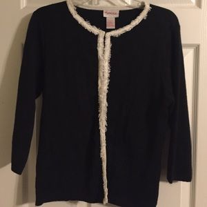 Sweaters - Black cardigan with white detail.