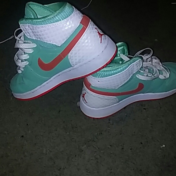 Pink , Mint Green and white Jordan 1s.