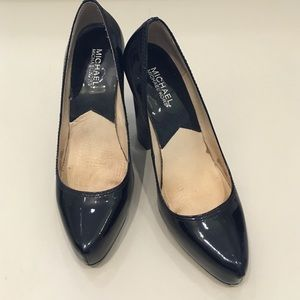 Michael by Michael Kors patent leather pumps.