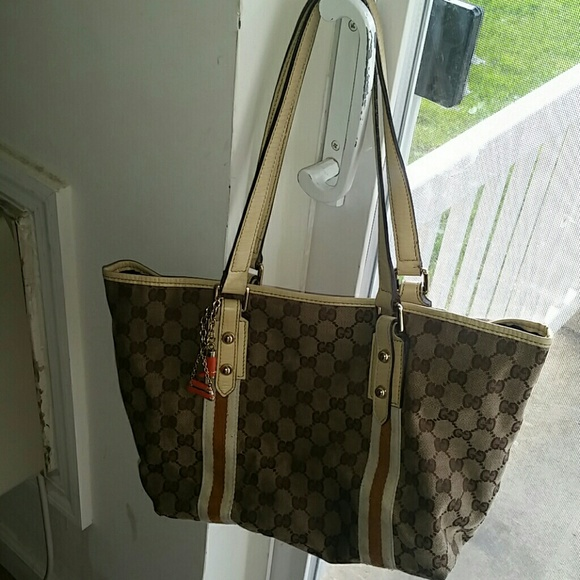 023bcafe039 Gucci Handbags - Authentic Gucci canvas beige and tan tote