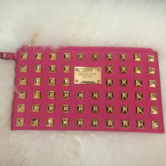 692fd31d4e17 Michael Kors pink studded clutch. M 562db0e1f0137d4e69014a96