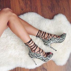 Raye lace up Python print heels.