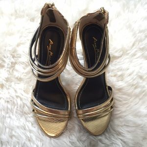 Metallic gold strappy heels.