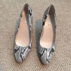 Leather Python print round toe heels.