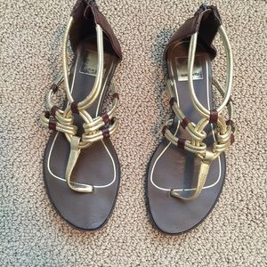 Metallic gold gladiator sandals.