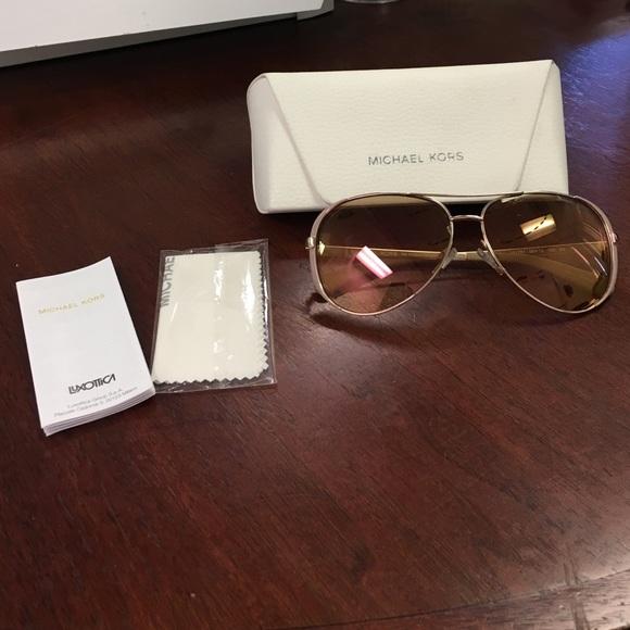 a81d28c0dc668 Michael Kors Rose Gold Chelsea Sunglasses. M 56326819729a66f456005d57