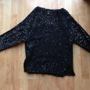 Sequin statement sweater.
