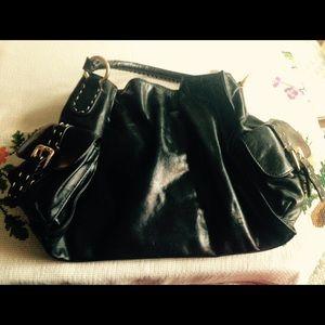 HYPE Black satchel with crisscross accents.