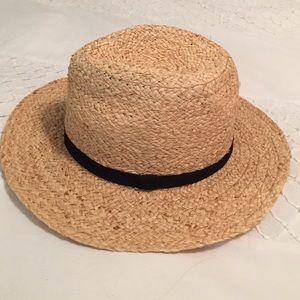 Tan straw hat with black brim trim