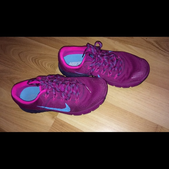 Wine nikes with blue and pink dotted laces