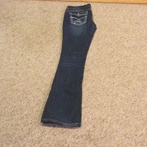 Amethyst size 7 jeans. Very cute! Small flare.