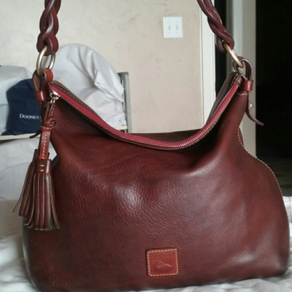 6c1c264239 Dooney   Bourke Handbags - Dooney   Bourke Flo chestnut twist strap hobo