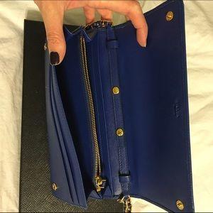 100% off Prada Handbags - Authentic Prada Wallet On Chain Blue ...