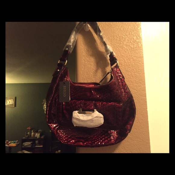 39% off Guess Handbags - NWT Guess deep red snake skin print purse ...