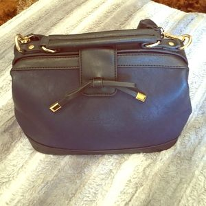 Handbags - Cutest navy blue handbag with the 🎀 in front