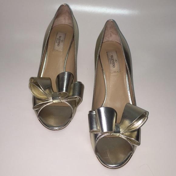 e5dafc3be9a56 Valentino Garavani Gold Metallic Peep Toe Bow Pump.  M_5640201b13302a0aeb020d62