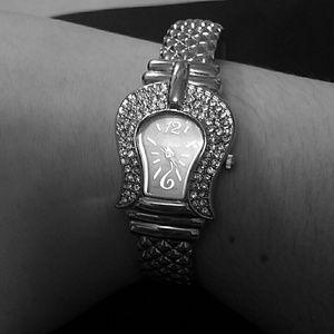 A silver  belt buckle watch