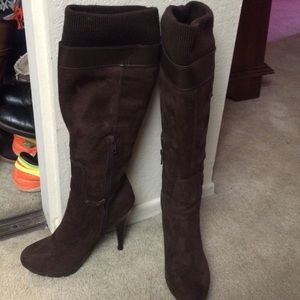 Knee high brown heeled boots