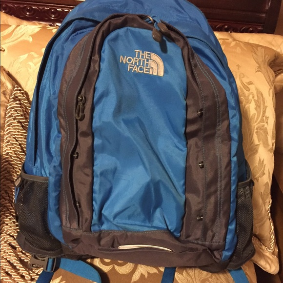 e97cd6c46883 Blue and gray north face backpack
