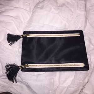 Black and creme bag with tassels