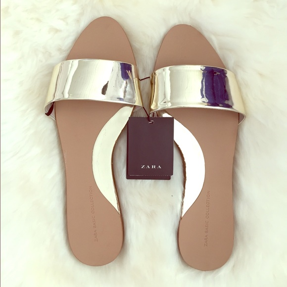 3bab2079d Zara slide sandals in metallic gold size 38.
