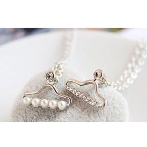 lucy6mahon Jewelry - Silver plated clothes hanger charm necklace