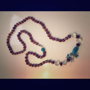 Long beaded turquoise necklace.