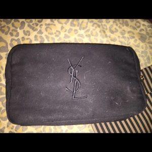 Black Yves Saint Laurent cosmetic bag on Poshmark
