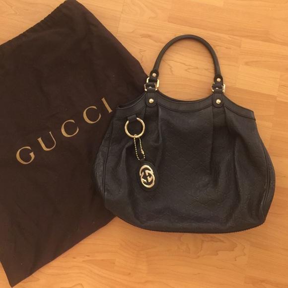 9b34c2b5bf7 Gucci Handbags - Gucci black leather medium Sukey bag