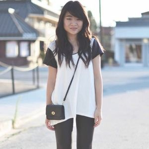 Tops - New white shirt with faux black leather sleeves
