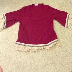 This is a quality top with Aztec inspired designs.