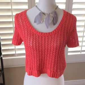Free People coral colored crochet knit sweater