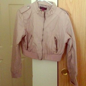 In great condition blush color crop jacket!!