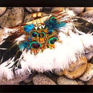 Feathered custom peacock clutch.