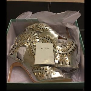 New gold and silver N.Y.L.A. Shoes