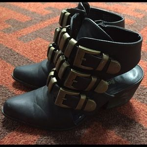 Black cut-out booties with gold buckles