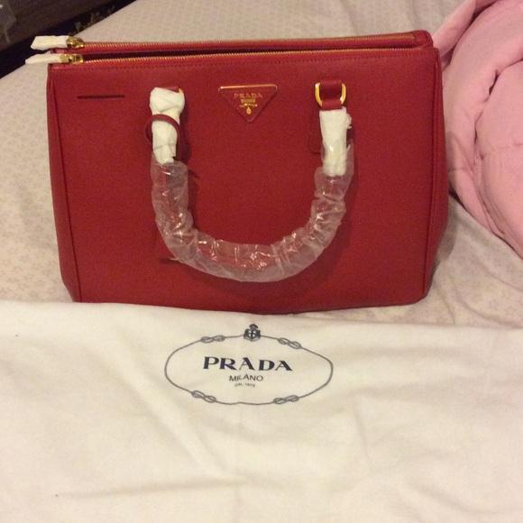 0bea3ab707 Prada saffiano leather double zip bag medium red. M 564aa2d2c6c7959377006913