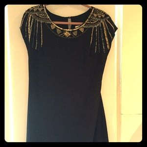 Black dress with beading at collar and shoulders