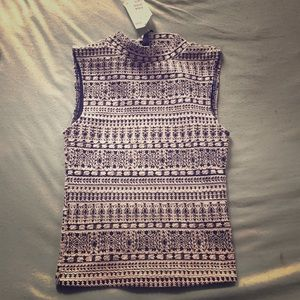 Black and white patterned mock neck top