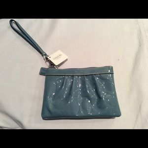 COACH EMBOSSED PATENT LEATHER WRISTLET.