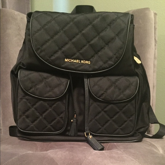 c21db26726ff Michael Kors quilted nylon large flap backpack. M_564d97d815c8afb9a1005388