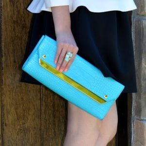 Turquoise clutch with gold detailing