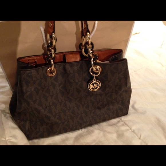ab4aa4d758c7 Michael Kors Signature Collection