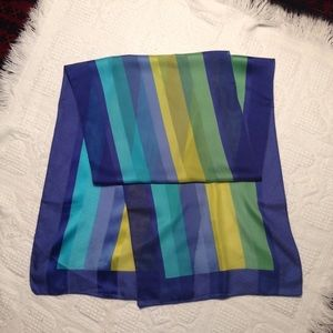 Bold colorful striped scarf.